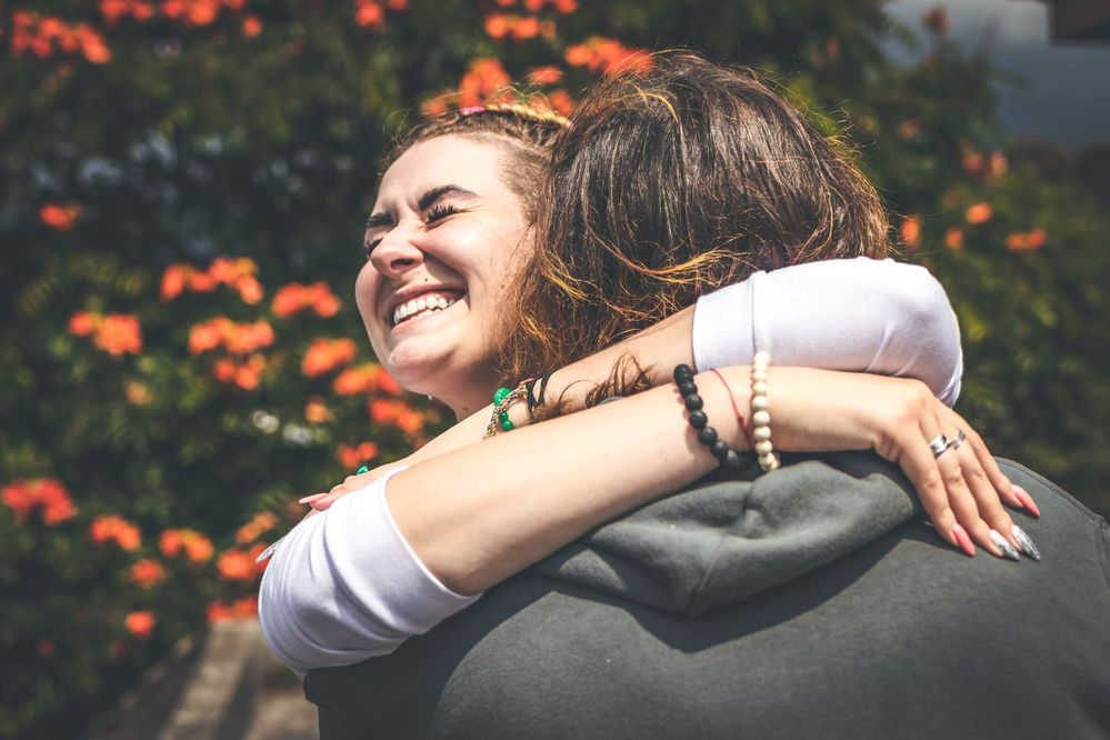 smiling-woman-hugging-another-person-2292932M.jpg